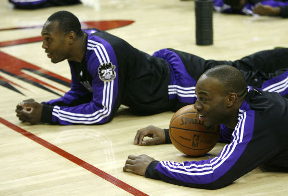 The Kings' Carl Landry and Joey Dorsey chat with former teammates upon their return to Houston. Photo: Karen Warren, Chronicle