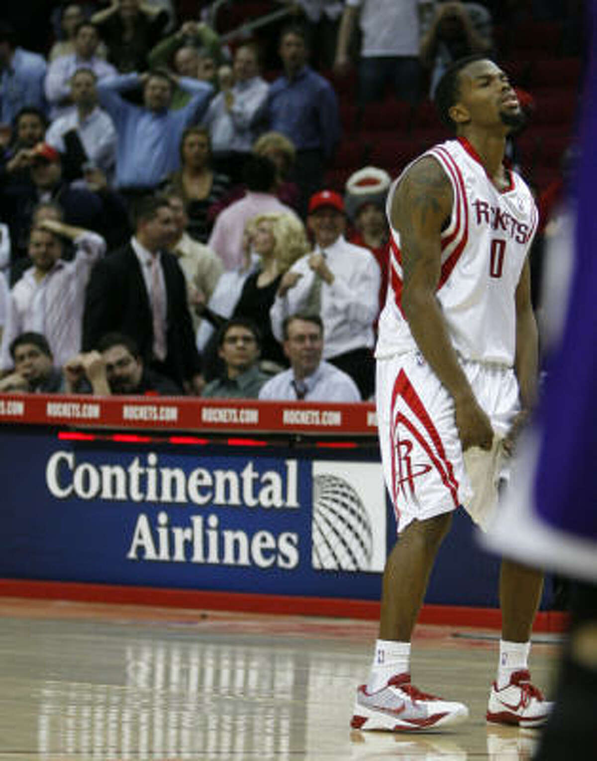 Aaron Brooks reacts after missing the first of his free throws with the Rockets down two points and six seconds left.