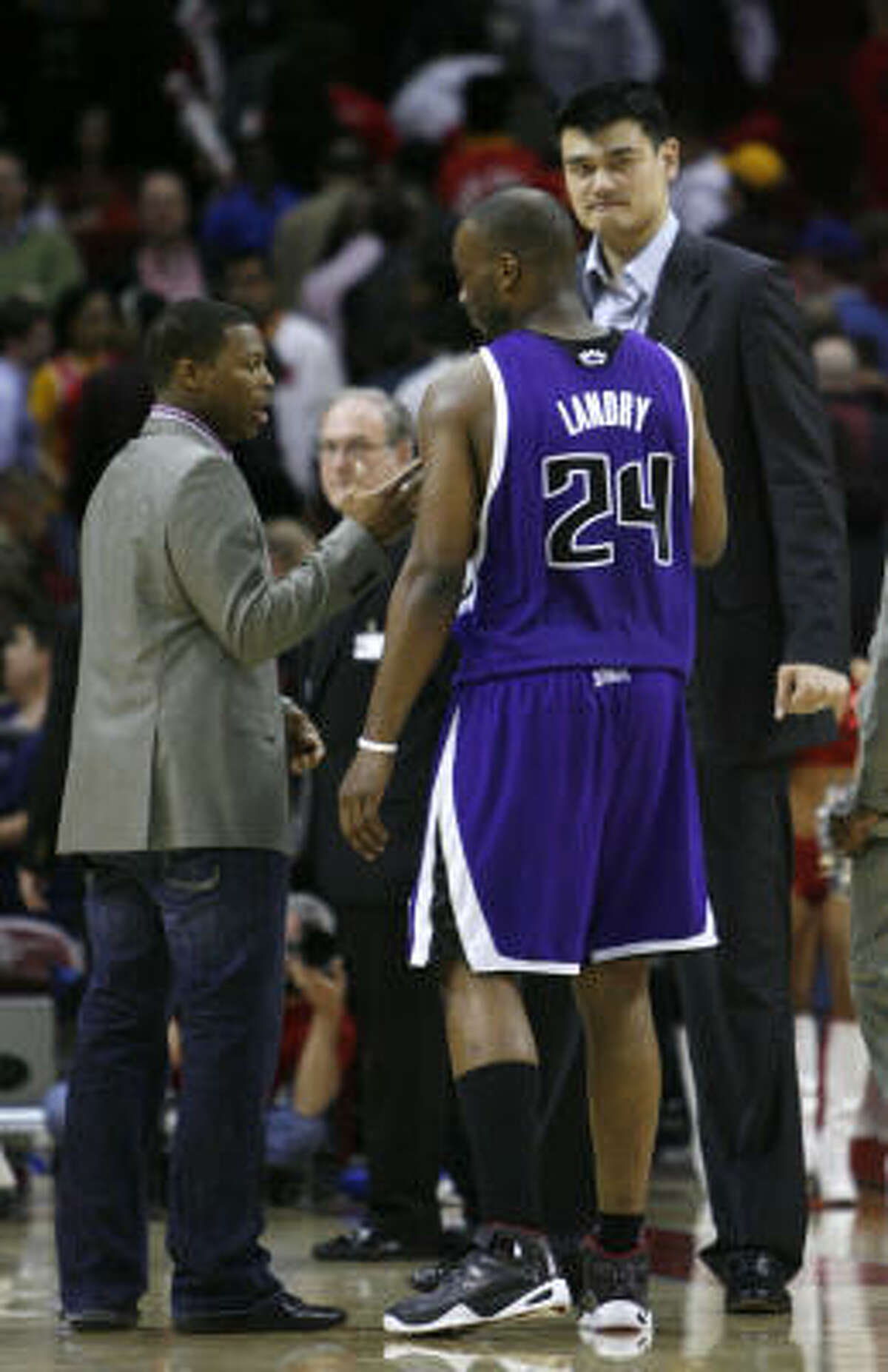 Carl Landry chats with Yao Ming after scoring 22 points to lead the Kings.