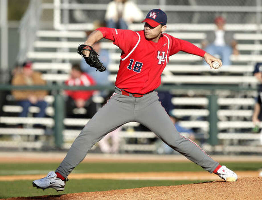 Houston pitcher Taylor Hammack throws against Rice. Photo: Bob Levey, For The Chronicle