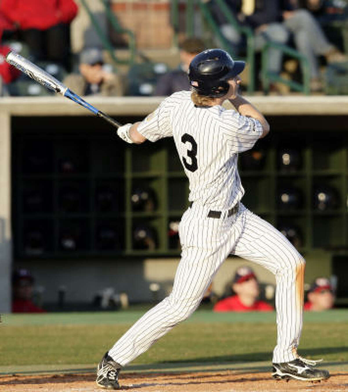 Rice's Jeremey Rathjen watches the ball leave the park as he hits a home run in the sixth inning.