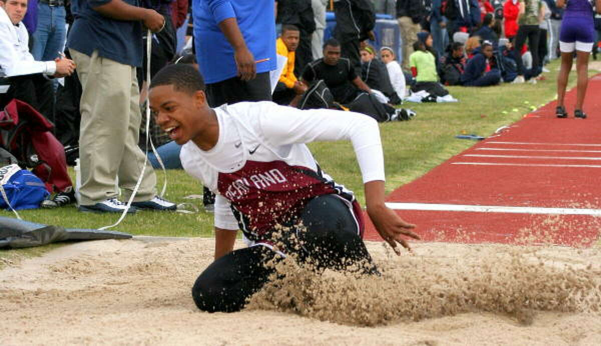 Pearland's DeAndre Robinson smiles as he makes his landing.