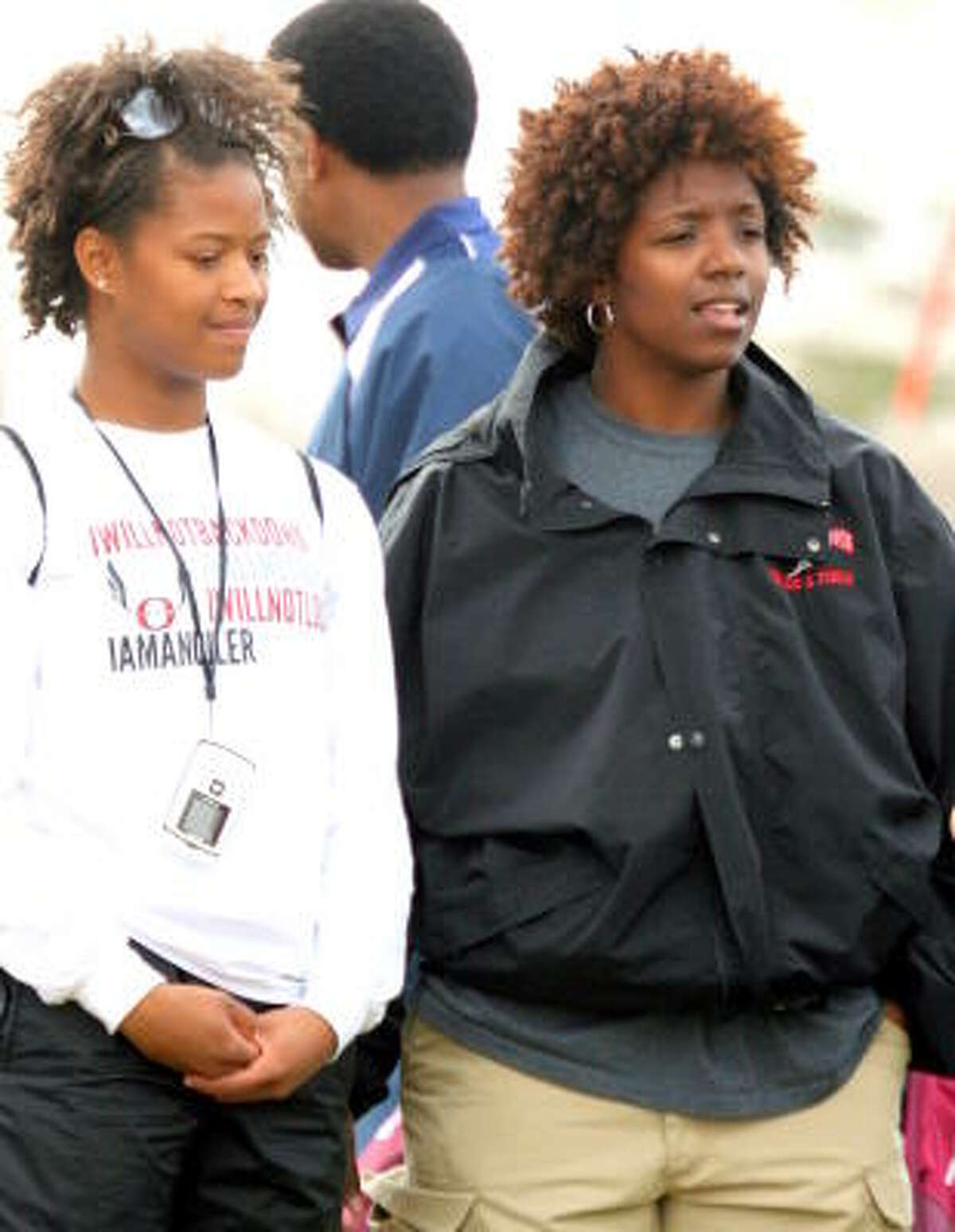 Pearland coach Roni Burren, right, watches with a student.