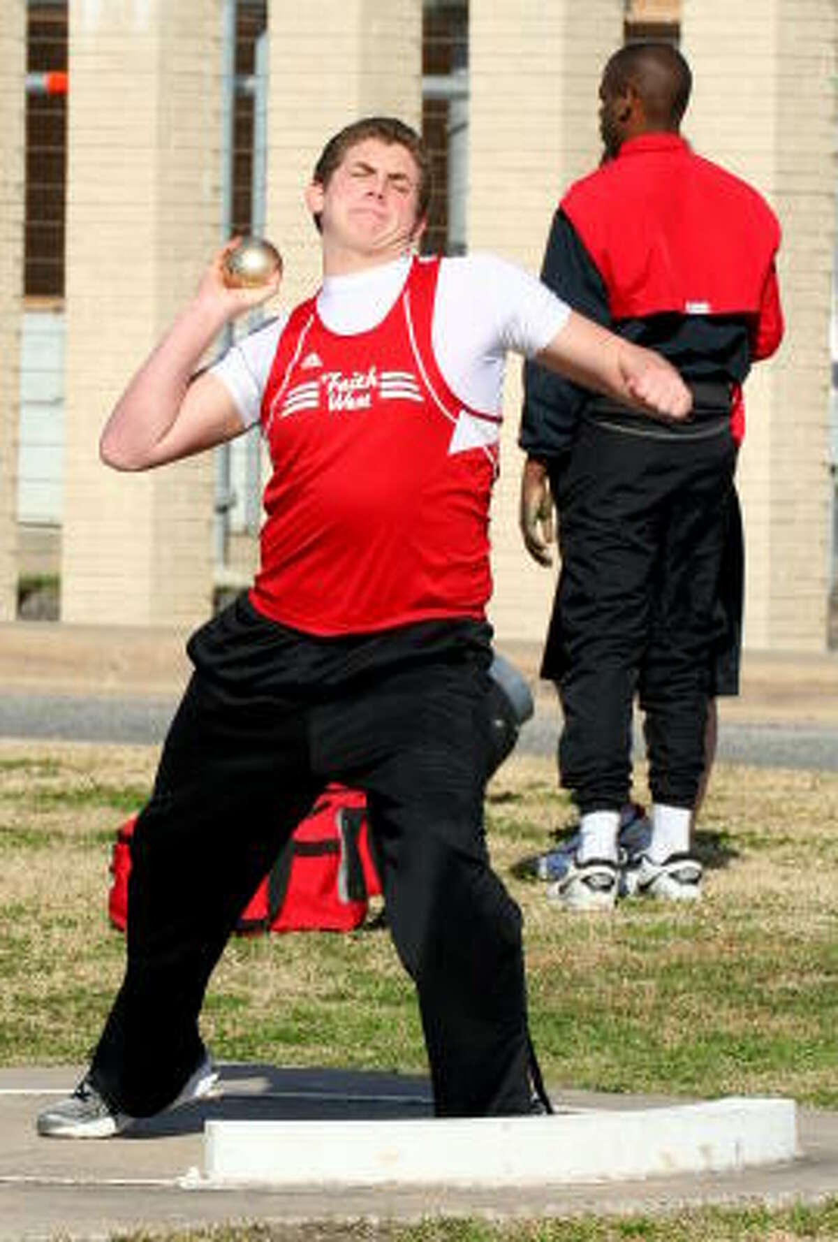 Jarren Brown from Faith West in Katy gives the golden ball all he has in the shot put.