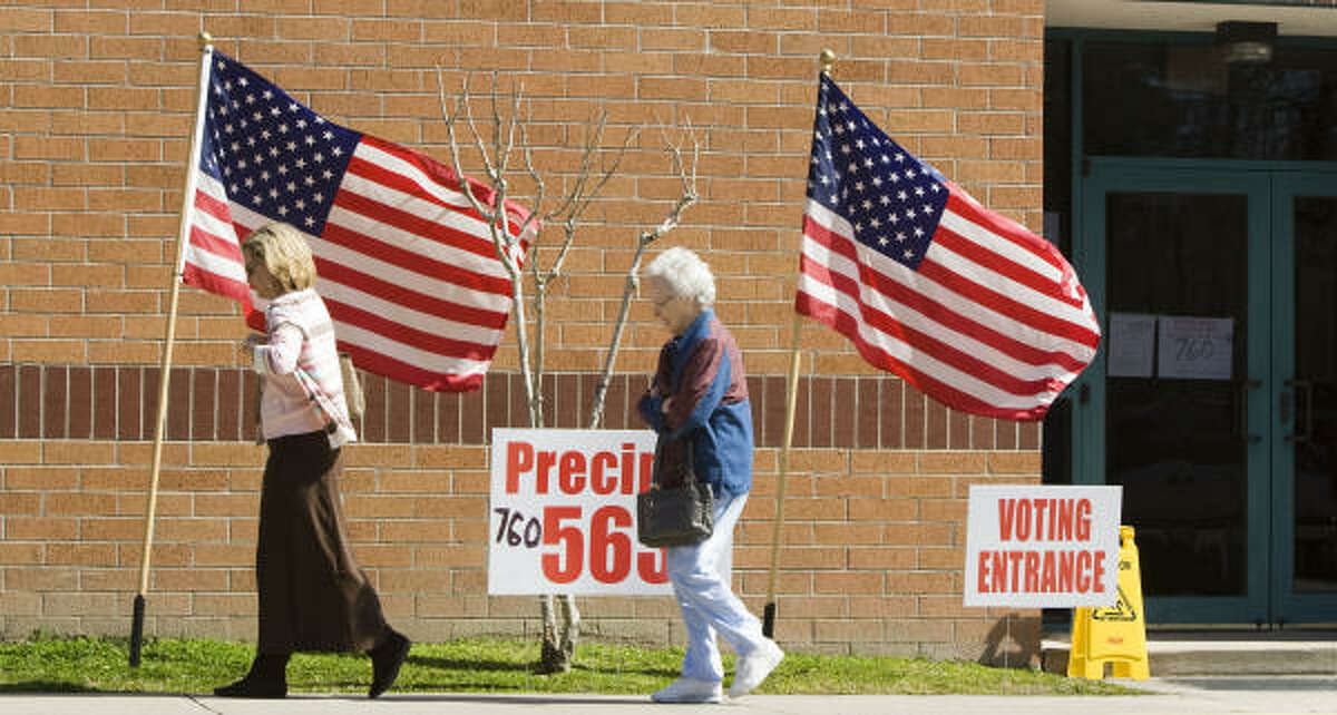 Voters leave the polling place for precincts 563 and 760 during primary voting at Riverwood Middle School on Tuesday.