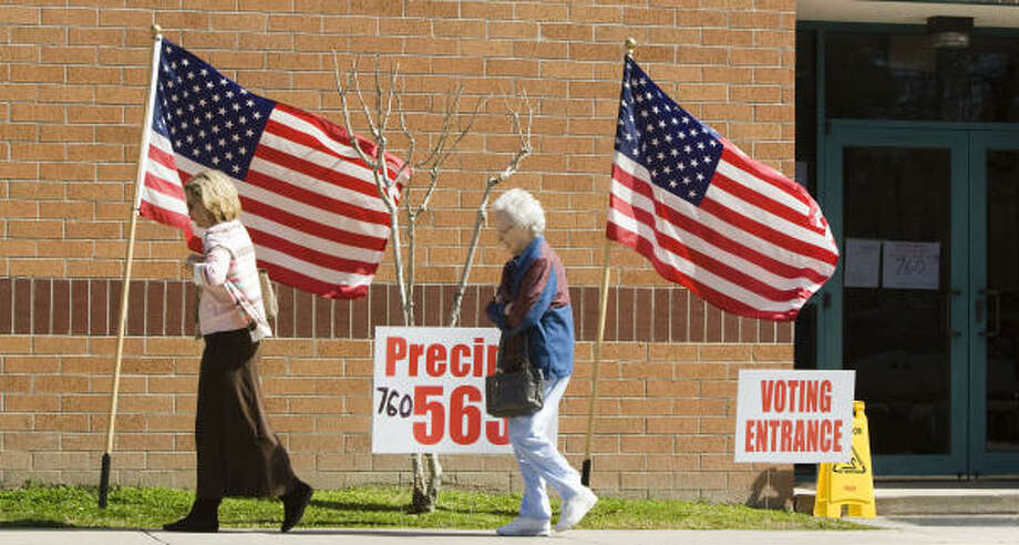 Voters leave the polling place for precincts 563 and 760 during primary voting at Riverwood Middle School on Tuesday. Photo: Brett Coomer, Chronicle