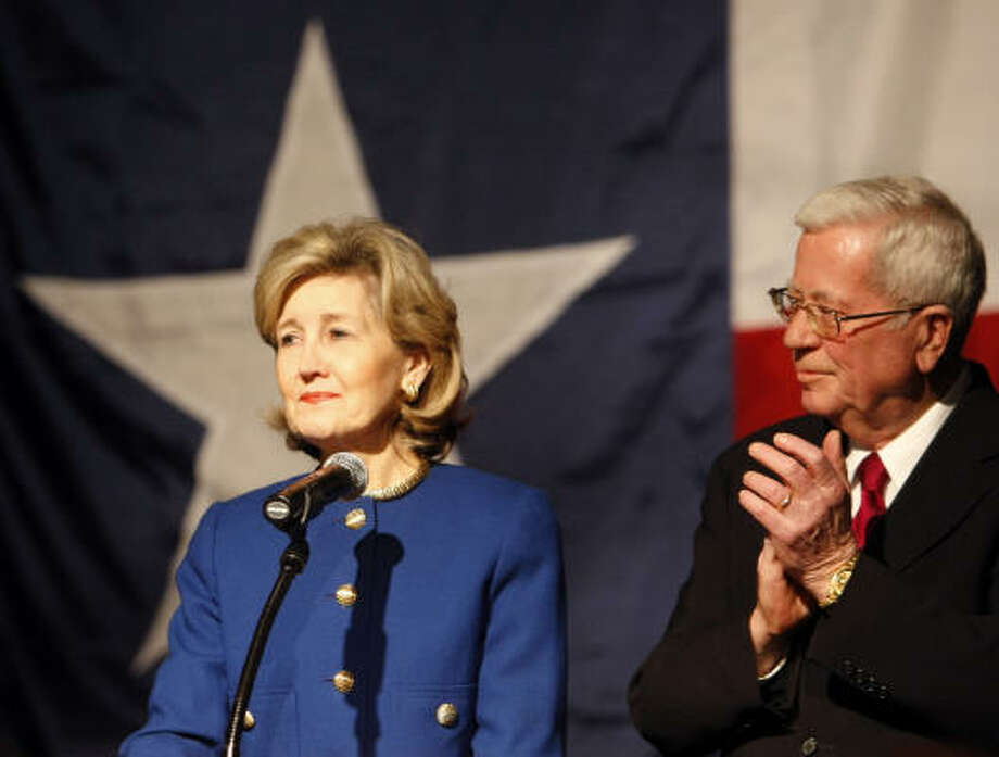 After conceding to incumbent Rick Perry, republican gubernatorial candidate Senator Kay Bailey Hutchison receives applause from her supporters and husband, Ray Hutchison, in this March 2010 file photo. Photo: Tom Fox, Dallas Morning News