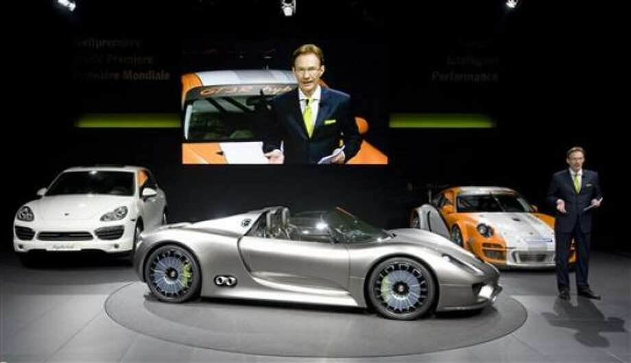 Porsche CEO Michael Macht presents three hybrid cars at the Geneva Motor Show in Geneva, Switzerland. The influx in hybrid models begs the question: Is the future now, or is this just attention-grabbing while the real powerhouse of the automotive world remains king combustion? Photo: Martin Meissner, AP