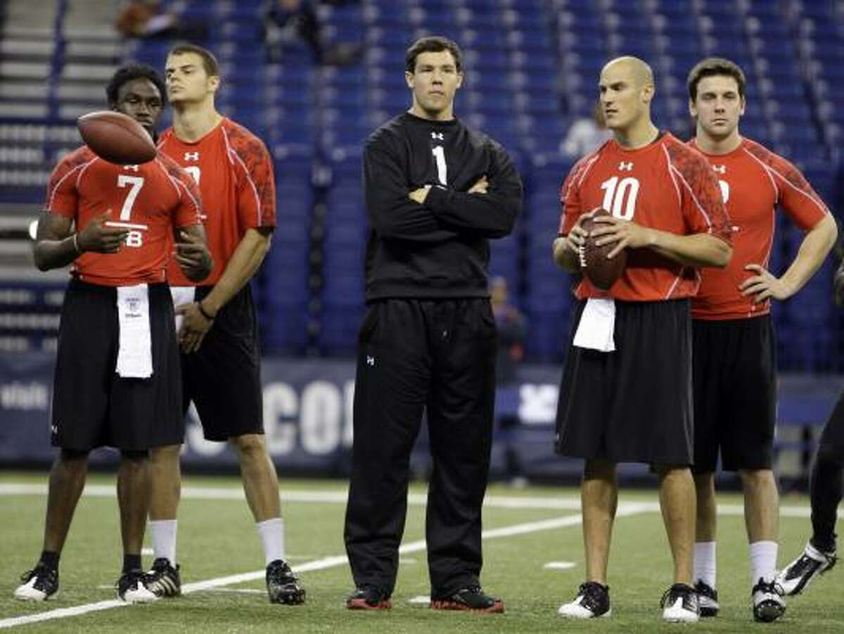 Oklahoma's Sam Bradford, center, opted not to throw at the NFL combine while he recovers from a shoulder injury. Despite the injury, Bradford is considered one of the top quarterback prospects and could even be the No. 1 pick.