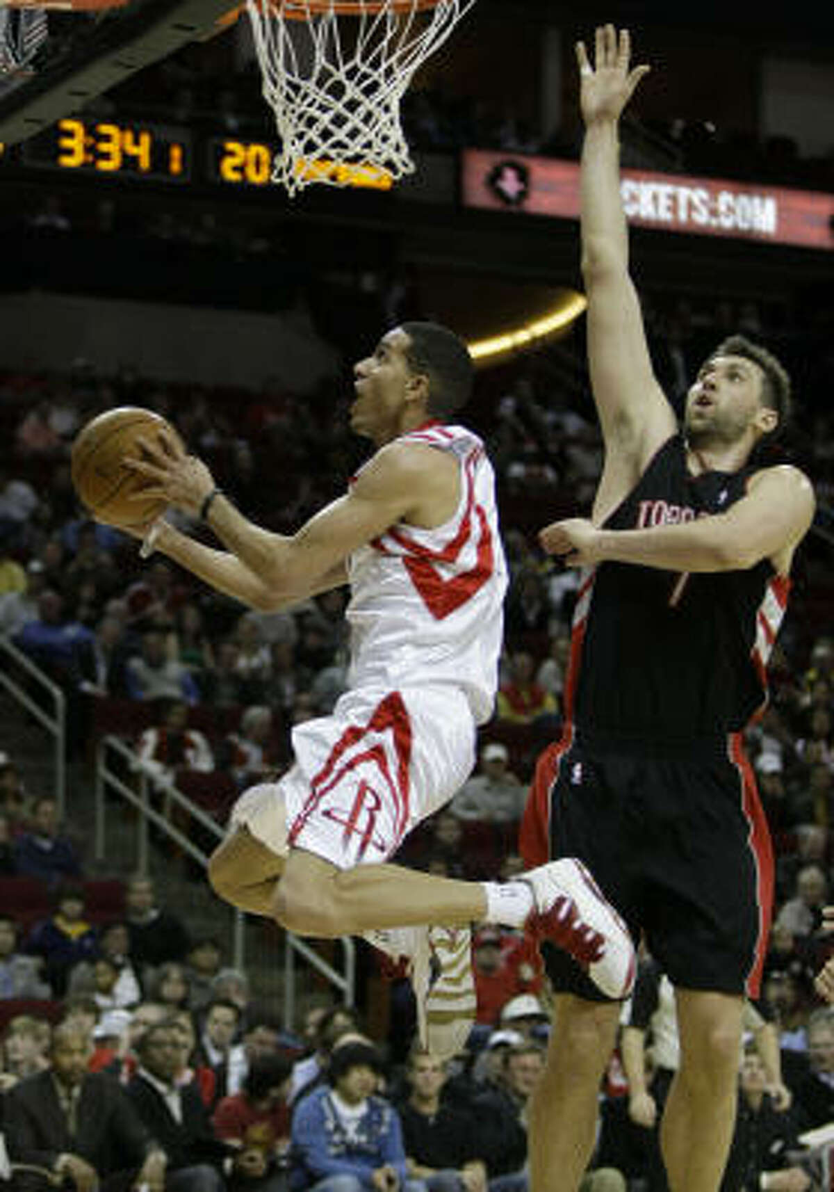 Kevin Martin leaps past Raptors center Andrea Bargnani for a layup. Martin scored 28 points on 9-for-16 shooting including five 3-pointers.