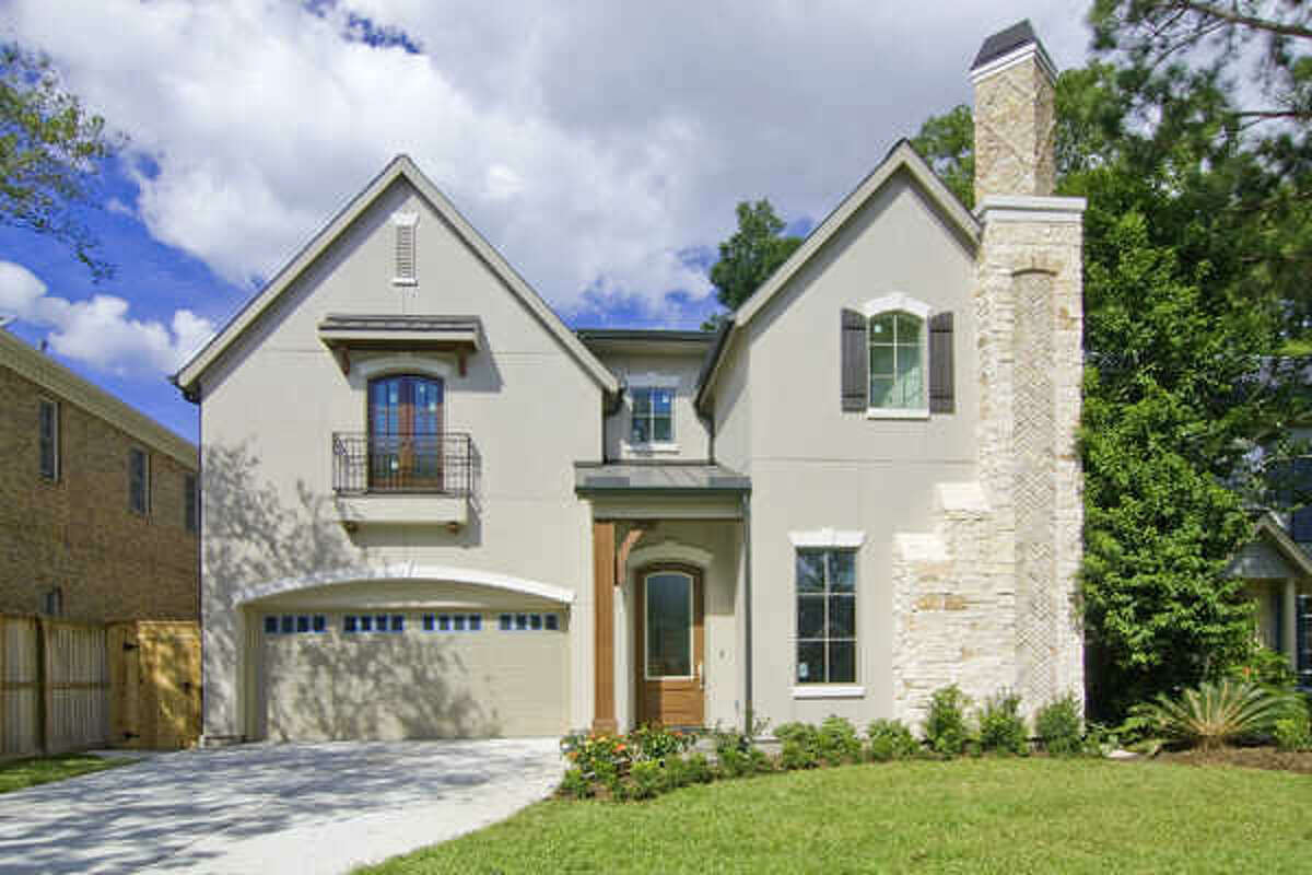 This property boasts stucco and stone exterior with a second-floor balcony.