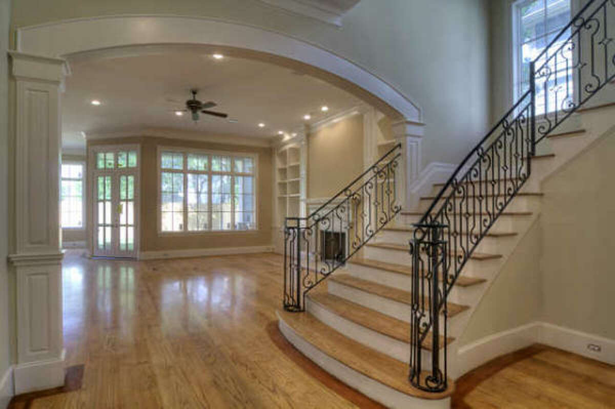 Another view of the stairwell and hardwood floors.