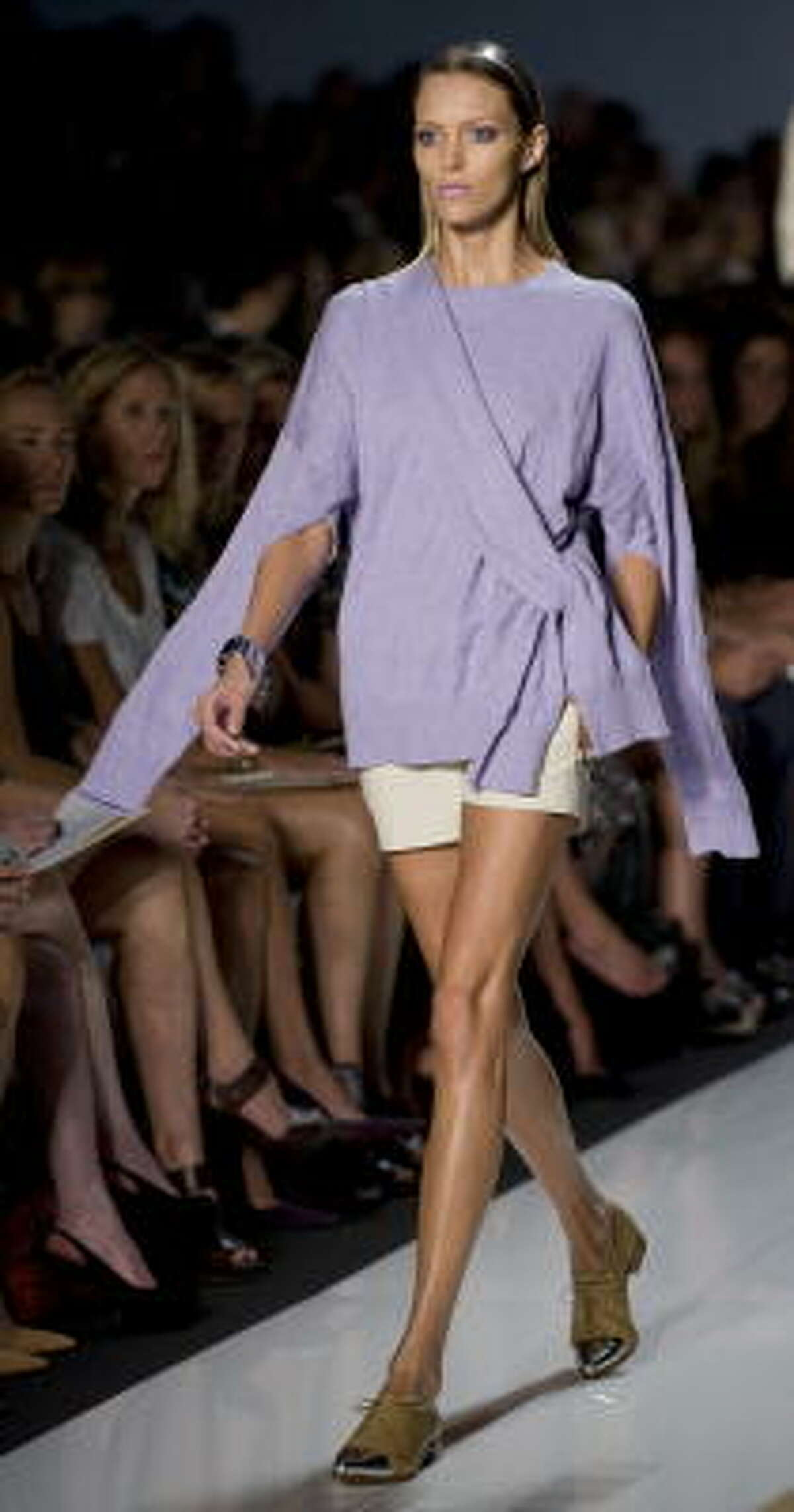 Amp up your legs with shorts. Balance out over-exposure of skin with a long sleeved, less revealing top.