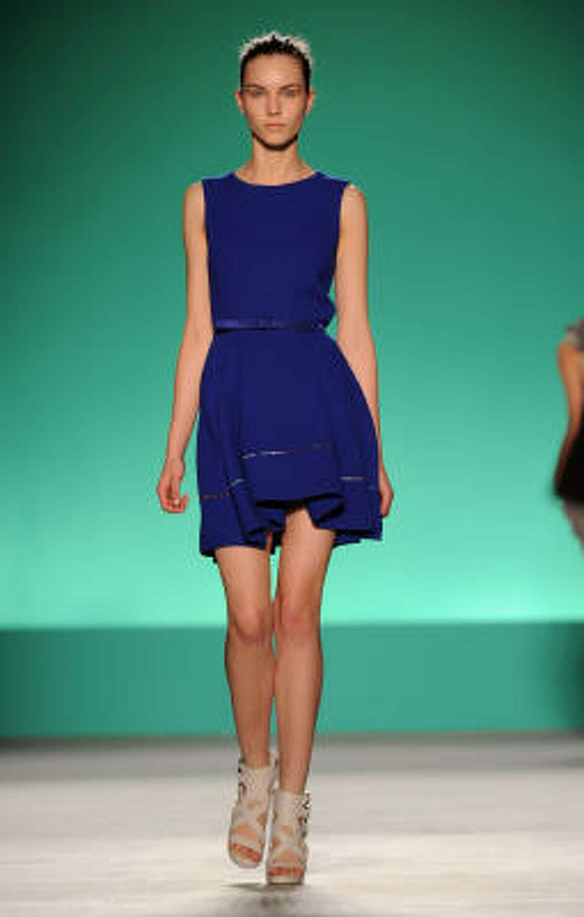 You can also play up leg length with neutral toned shoes paired with an above knee length skirt.