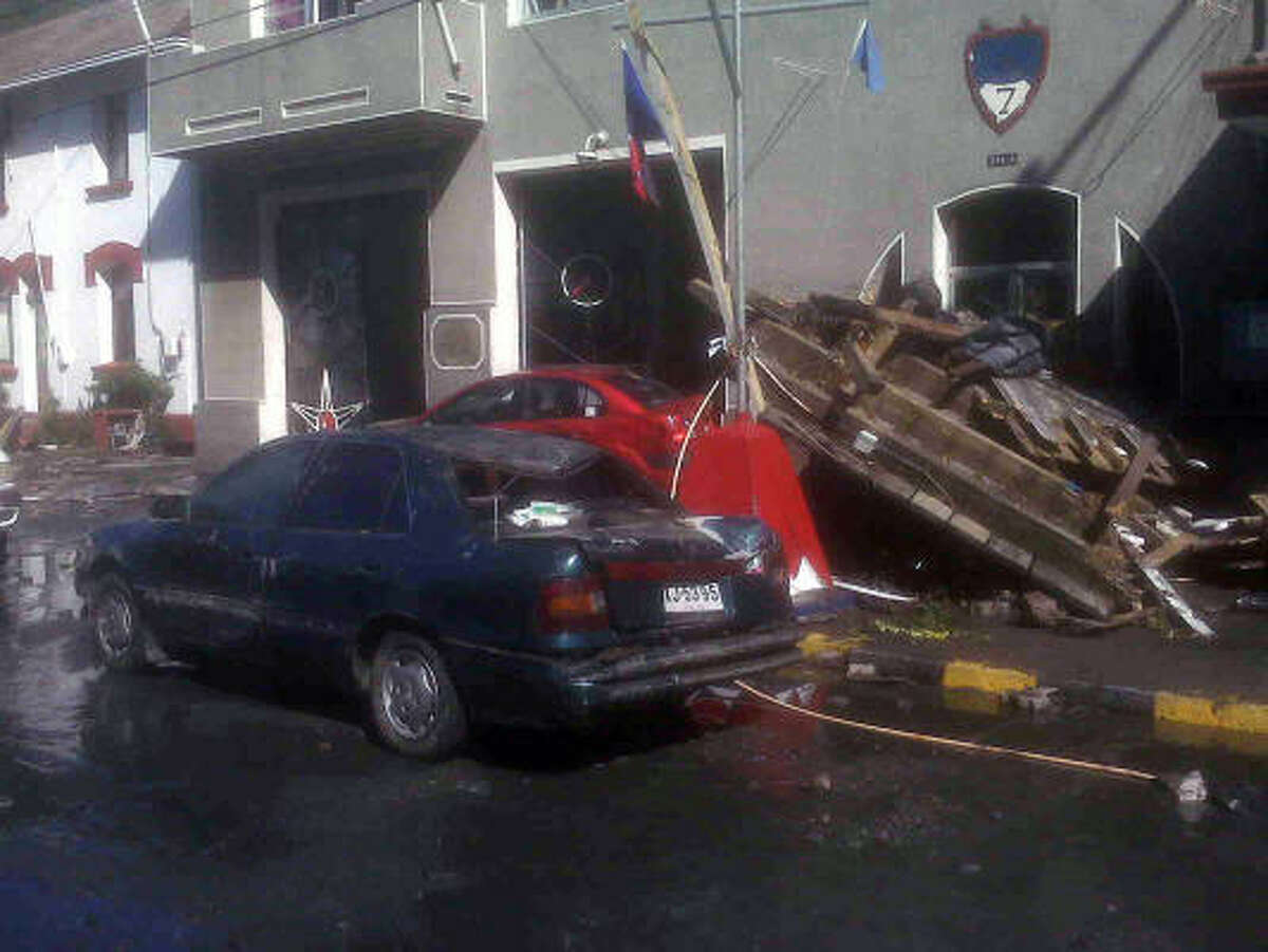 Damaged cars sit at the naval base of Talcahuano, Chile, on Feb. 28, a day after the quake.