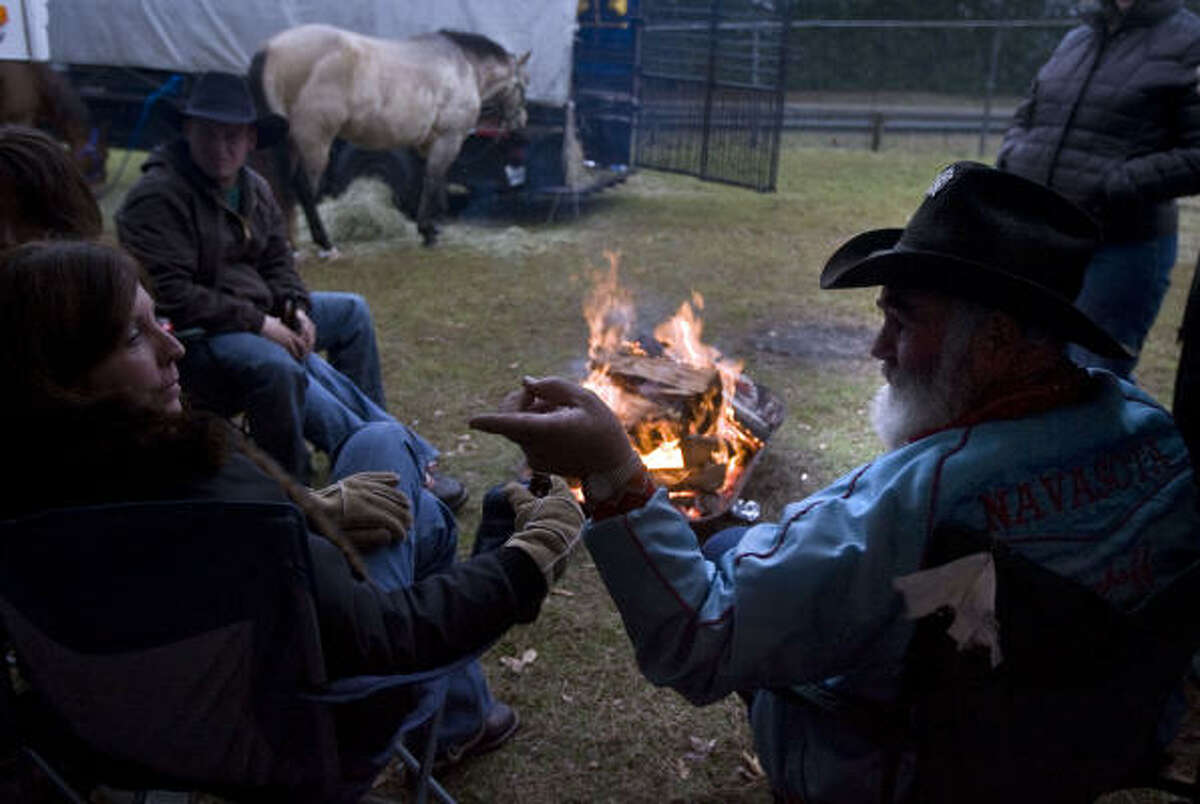 Sam Houston Trail Ride members Linda Springer chats with Jim Boy Harrington at the groups overnight stop at Spring Creek Park in Tomball.