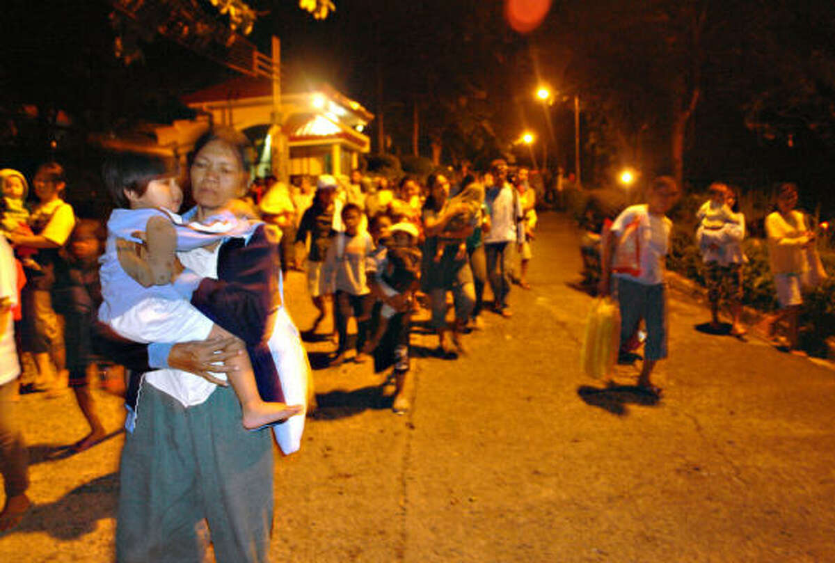 Warned about tsunamis, Filipinos head to higher ground at the coastal city of Tandag, in southeastern Philippines.