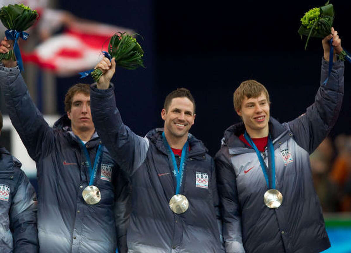 Chad Hedrick receives the final medal of his Olympic career, the silver from the men's team pursuit.
