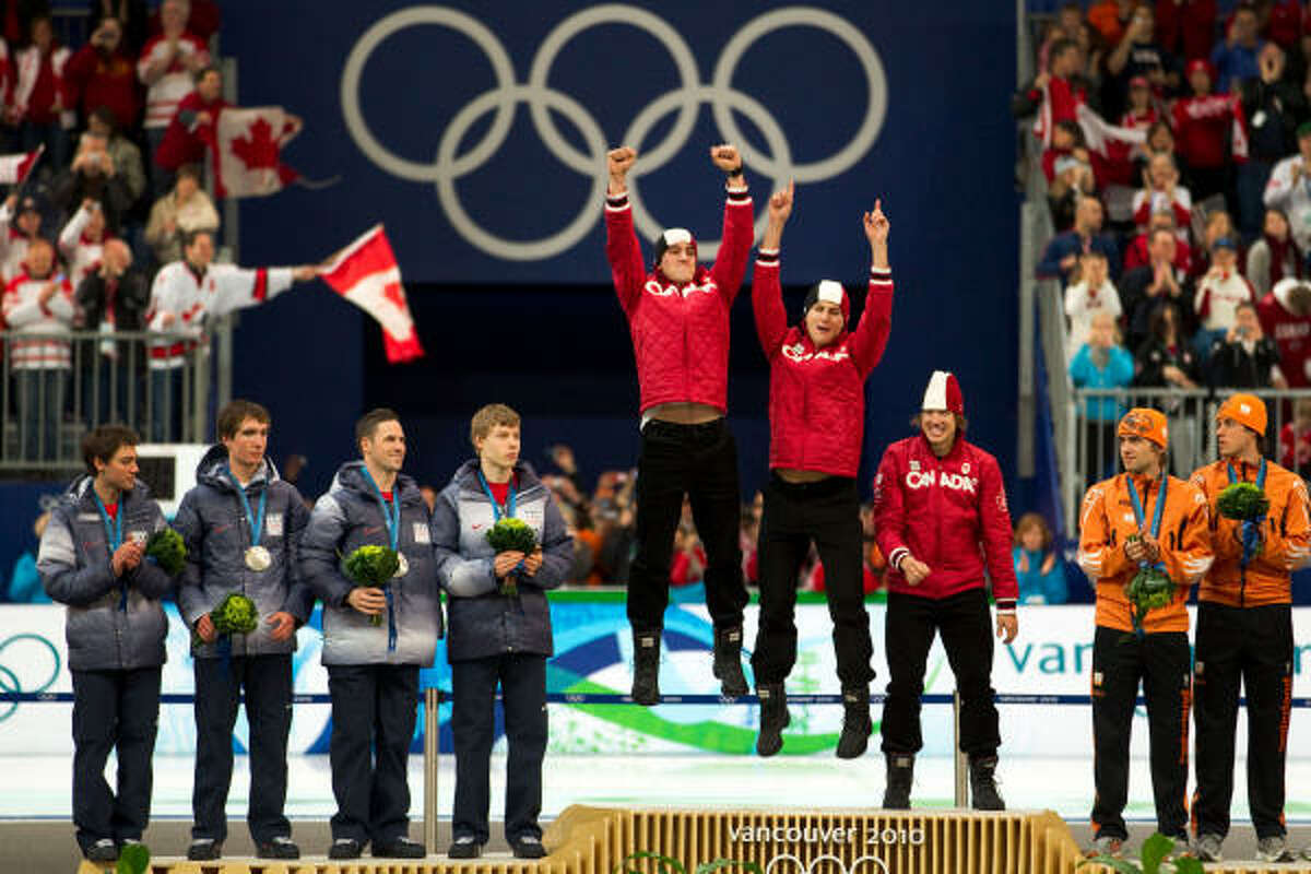 Chad Hedrick, with his team pursuit teammates, stands on an Olympic platform for the last time.