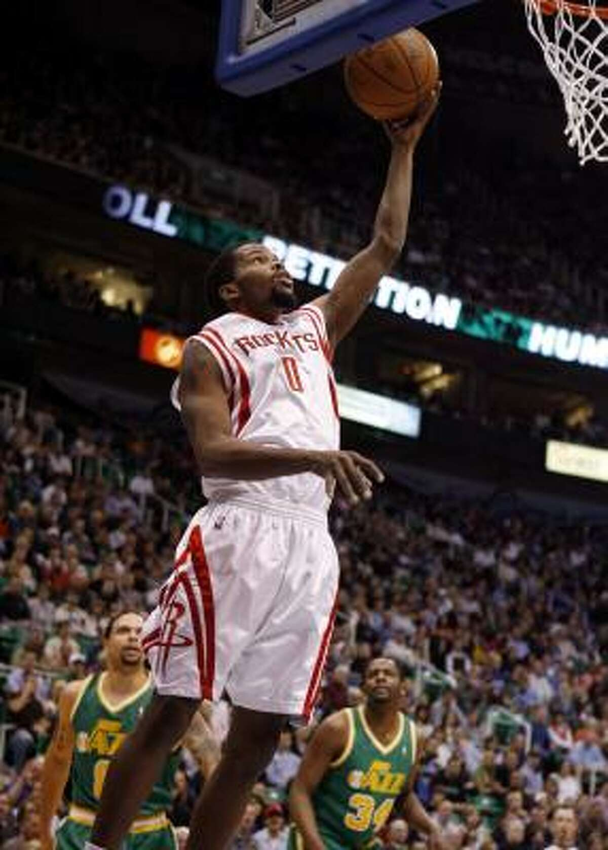 Rockets guard Aaron Brooks drops in a layup during the first half.