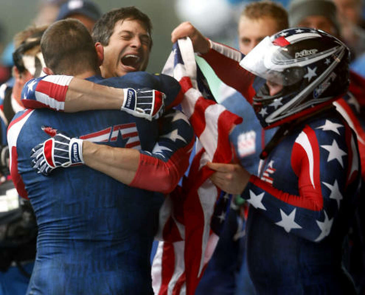 American Steve Mesler and his USA 1 teammates celebrate their victory in the four-man bobsled competition.