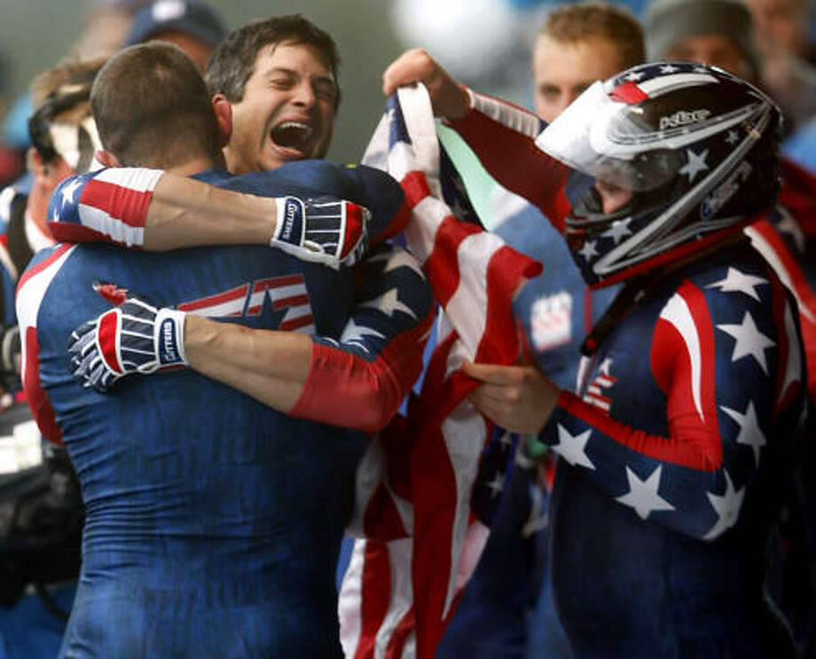 American Steve Mesler and his USA 1 teammates celebrate their victory in the four-man bobsled competition. Photo: Paul Chinn, Chronicle Olympic Bureau