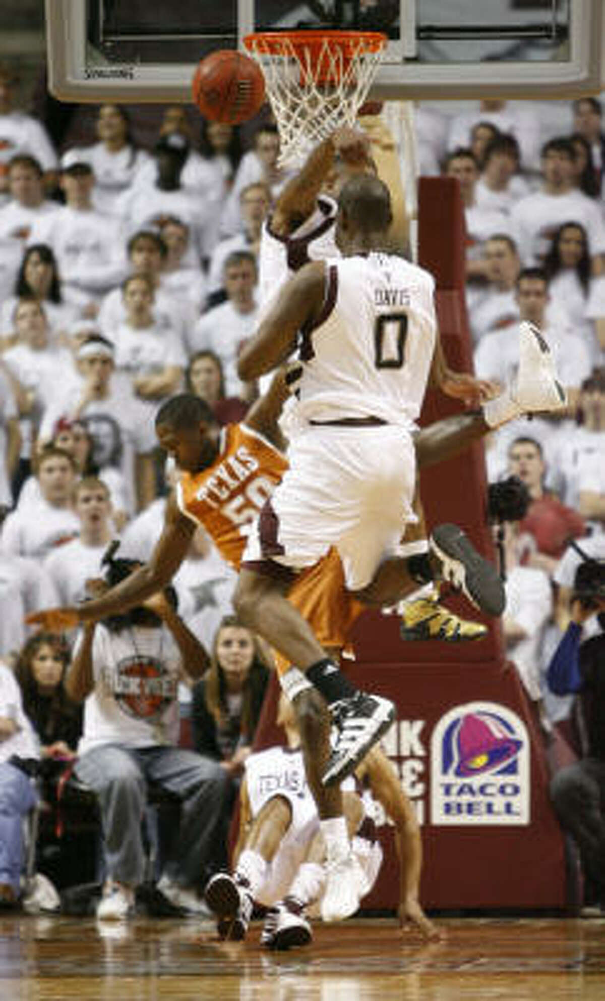 Texas guard J'Covan Brown (50) looses his footing on a drive to the basket and hurts his head in the second half. He was taken off the court in a stretcher.