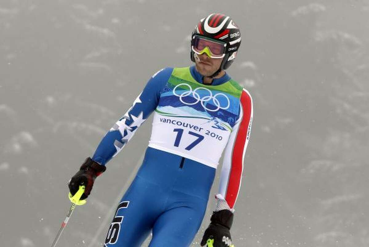 Bode Miller of the United States reacts after skiing out just eight seconds into his first run.