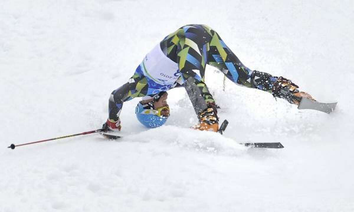 Norway's Lars Elton Myhre crashes during the first run.