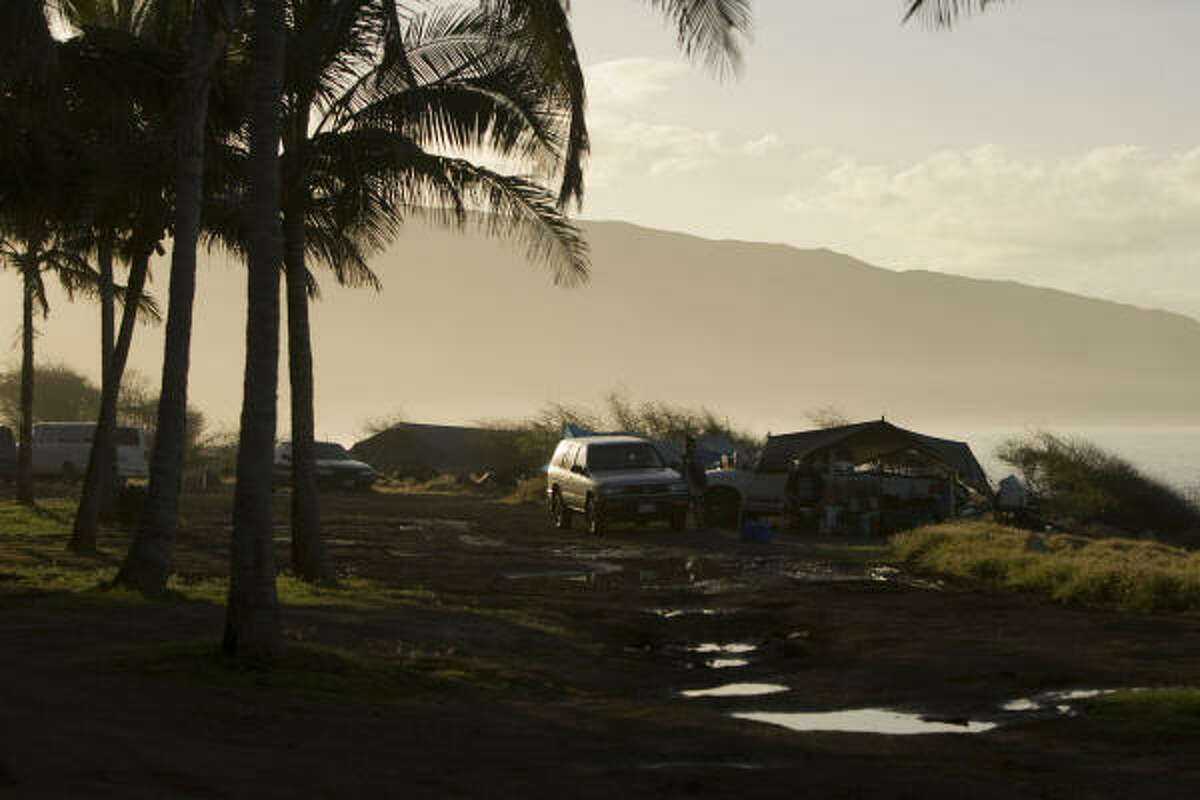 Homeless campers evacuate their campsite on Maile Beach, Saturday, Feb. 27, 2010 in Waianae, Hawaii.