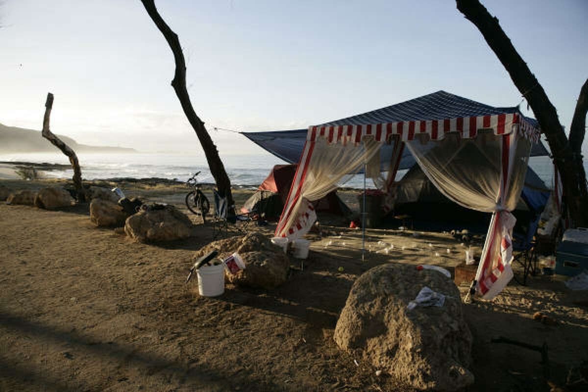 A homeless camp sits empty after officers from the Hawaii Department of Emergency Management warned campers of a possible tsunami on Maile Beach, Saturday, Feb. 27, 2010 in Waianae, Hawaii.