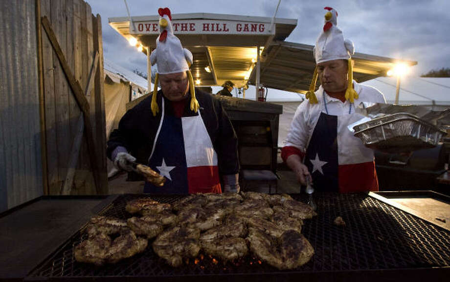 "Gary Groschke (left) and Jack Deboer (right) with the ""Over the Hill Gang"" team cook chicken at the Houston Livestock Show and Rodeo ""World's  Championship Bar-B-Que Contest at Reliant Park Friday, Feb. 26, 2010, in Houston. Photo: James Nielsen, Chronicle"