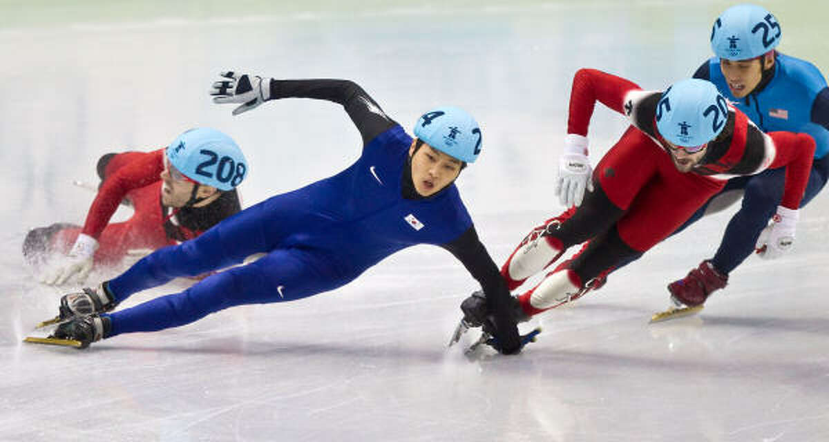 Bodies fly as (from left) Canada's Francois-Louis Tremblay, Korea's Sung Si-Bak, Canada's Charles Hamelin and USA's Apolo Anton Ohno enter the final run during the men's 500-meter finals in short track speed skating. Ohno was disqualified after the race.