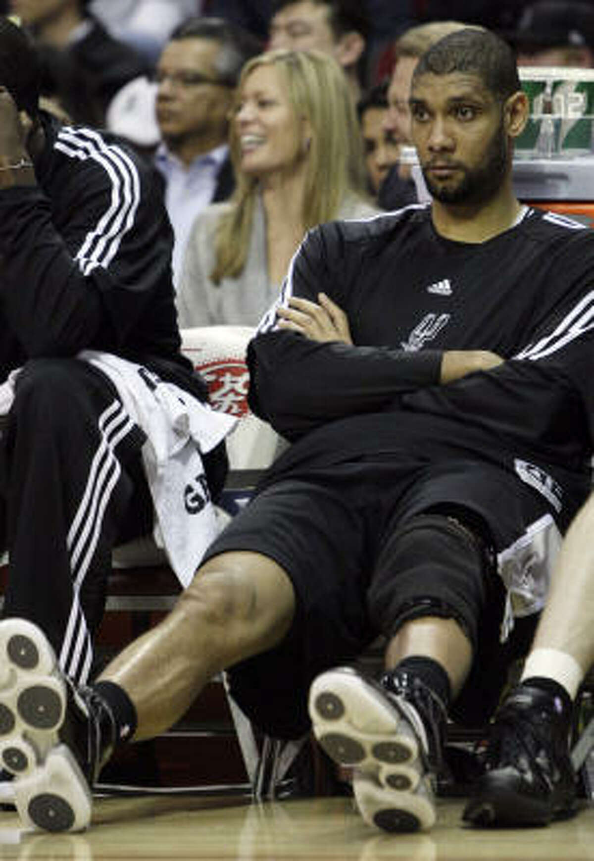 Spurs forward Tim Duncan sits on the bench during the Spurs' loss at the Toyota Center.