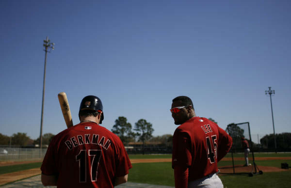 Astros first baseman Lance Berkman, left, and outfielder Carlos Lee converse while waiting for their turn at the plate during live batting practice Friday at Osceola County Stadium in Kissimmee, Fla.