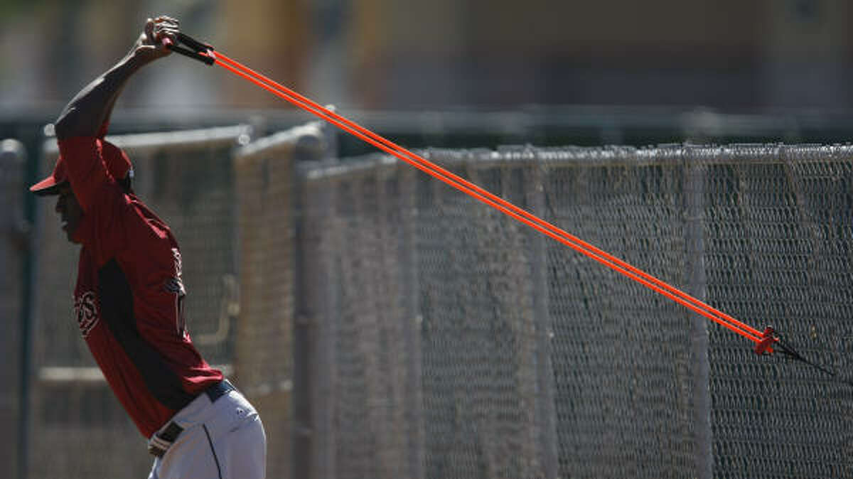 Astros pitcher Jose Valdez works on his arms.