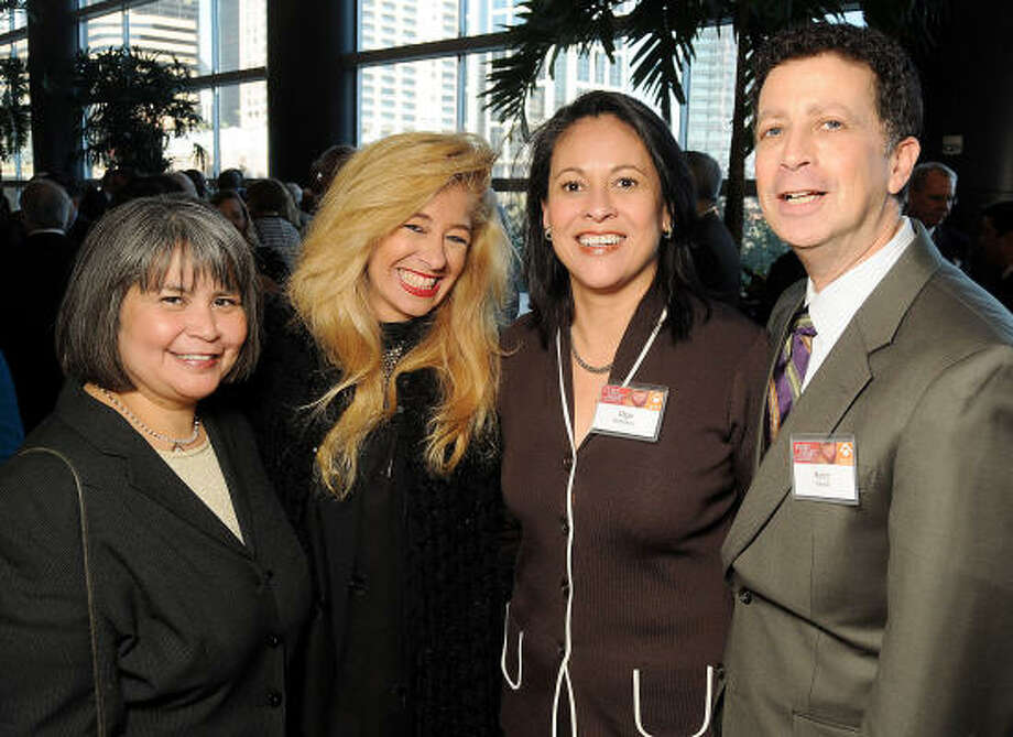 From left: Gloria Moreno, Sofia Adrogue', Olga Rodriguez and Barry Mandel at the Heart of Gold Celebration benefiting Neighborhood Centers Inc. at the Hilton Americas-Houston. Photo: Dave Rossman, For The Chronicle