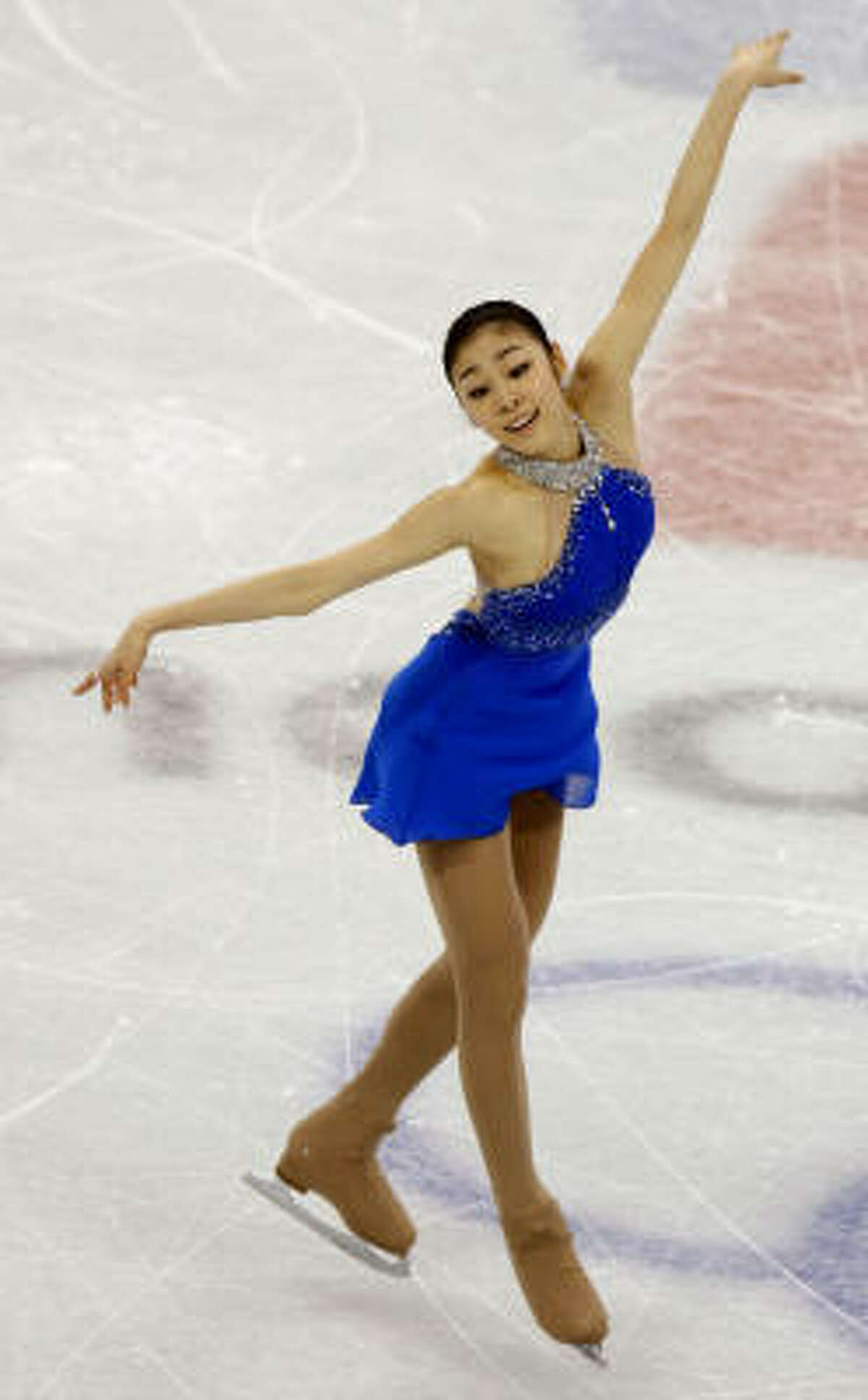 Kim Yu-na of South Korea wins the gold medal in the free program at the age of 19.