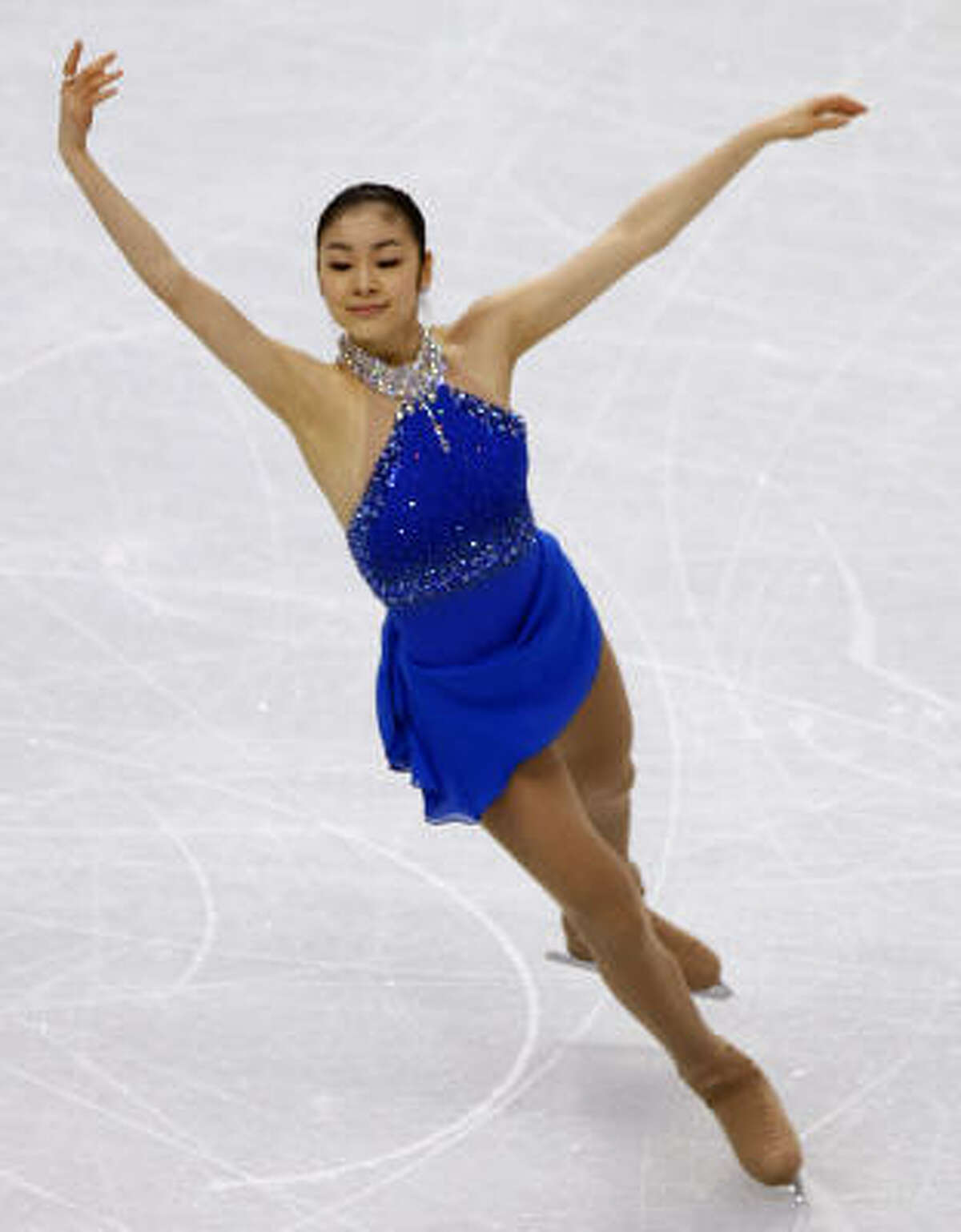 Kim Yu-na wins the first figure skating medal for South Korea.