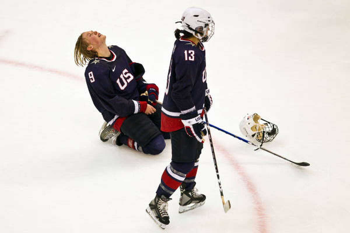 USA's Molly Engstrom and Julie Chu react after the USA lost to Canada.