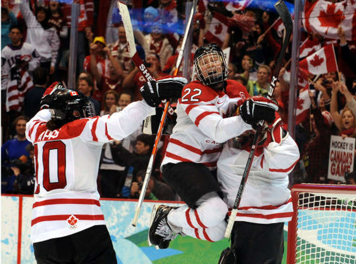 Members of the Canadian team celebrate their win.