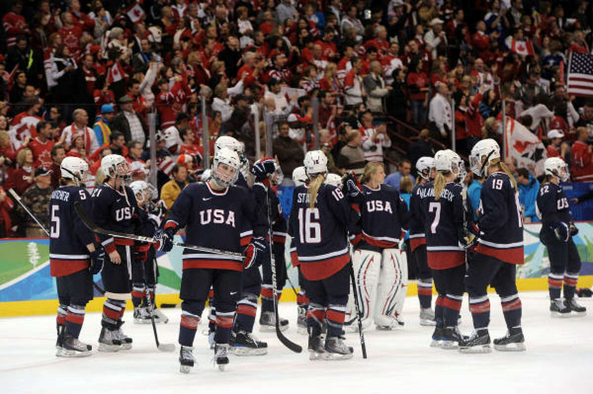 A dejected Team USA looks on following their team's 2-0 loss in the gold medal game.