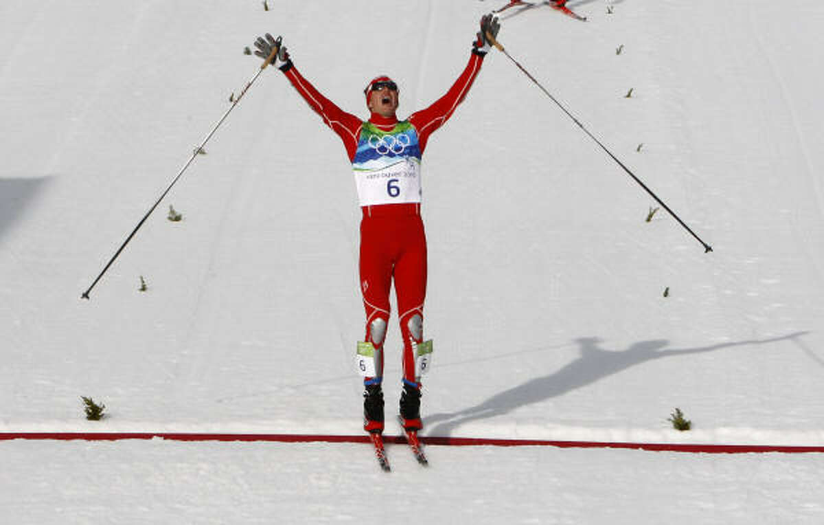 The United States' Bill Demong crosses the finish line to win the gold medal during the men's nordic combined Individual event Feb. 25.