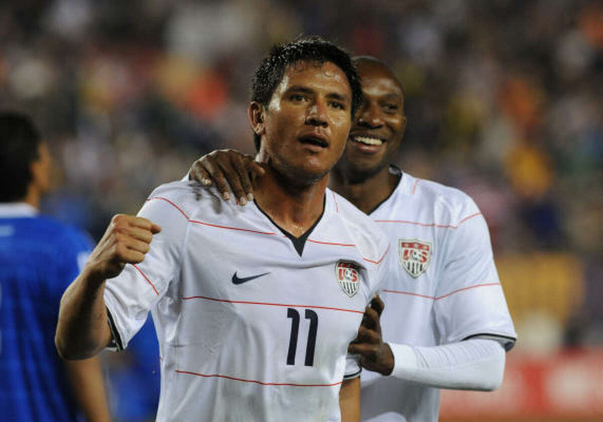 Houston Dynamo and U.S. striker Brian Ching celebrates after scoring on a diving header to tie the game in the second half.