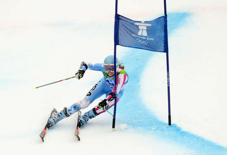 Julia Mancuso clears a gate during her second run. Photo: EMMANUEL DUNAND, AFP/Getty Images
