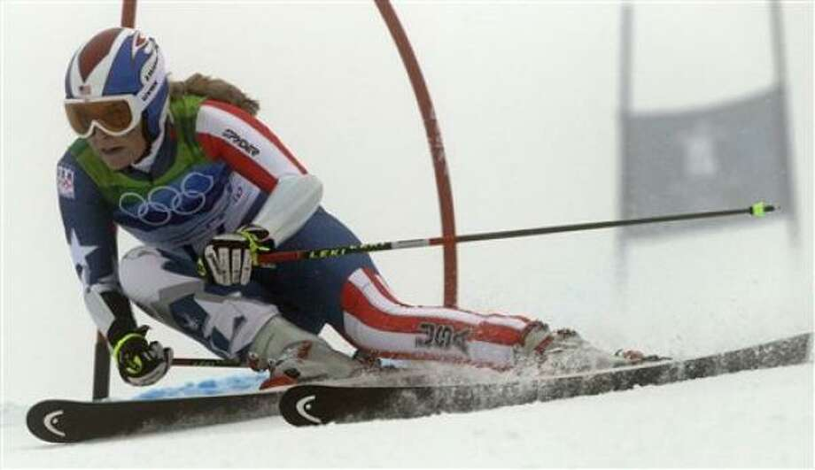 Lindsey Vonn of the United States passes a gate during the first run of the women's giant slalom Feb. 24. Vonn crashed out on the run. Photo: Charlie Krupa, AP