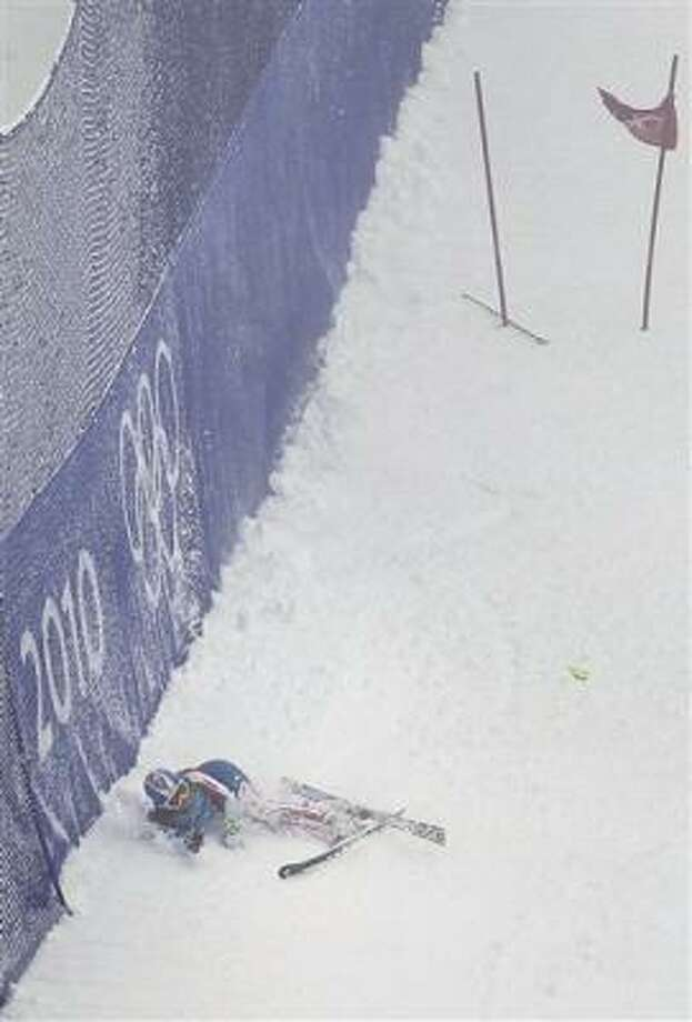 Lindsey Vonn lays in the snow after crashing. Photo: Sergey Ponomarev, AP