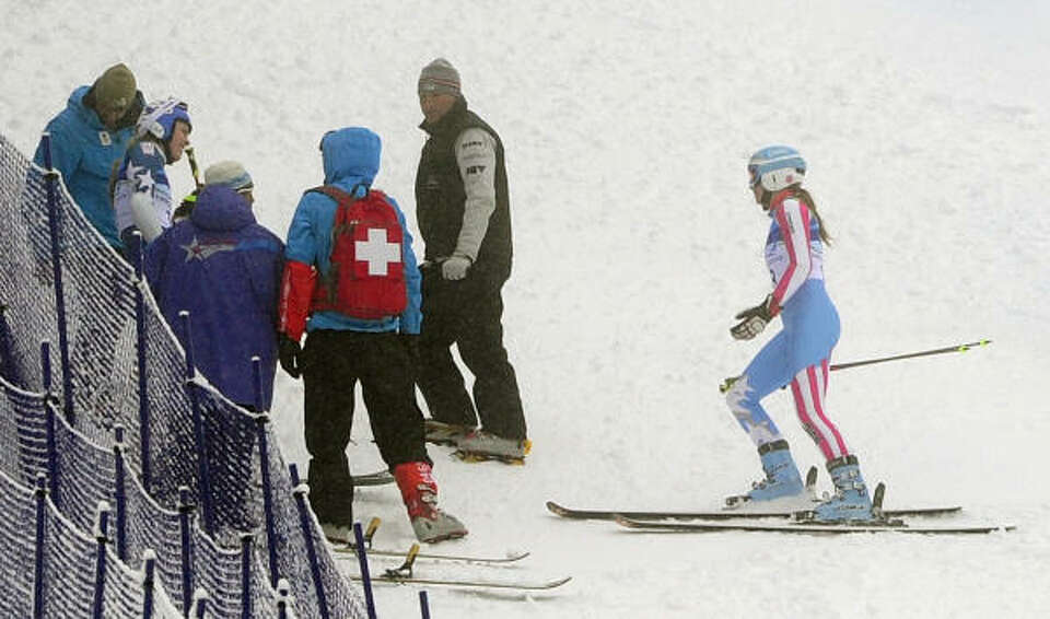 Team USA's Julia Mancuso stops her race to check on Lindsey Vonn. Mancuso was allowed to re-start.