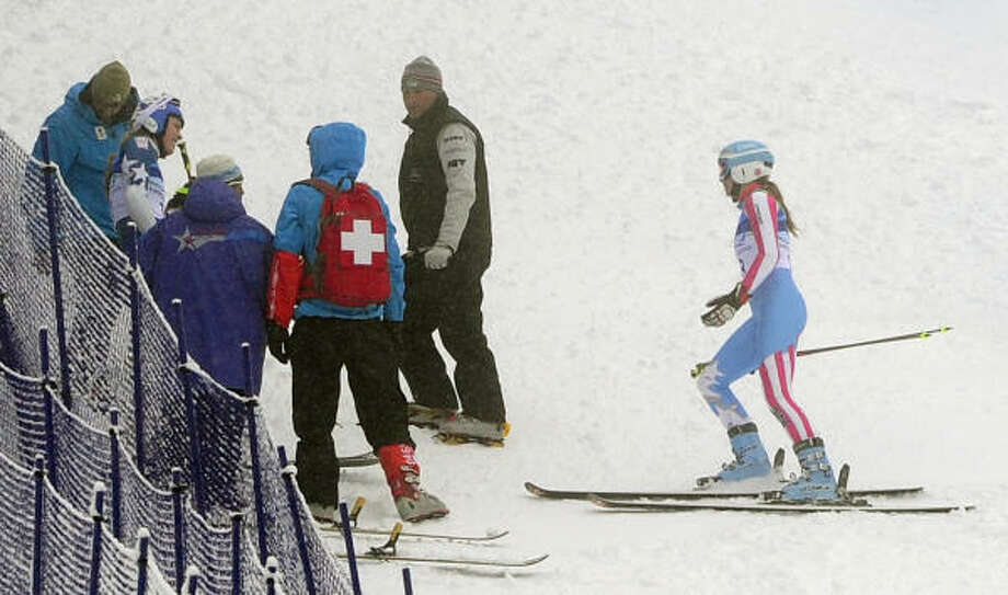 Team USA's Julia Mancuso stops her race to check on Lindsey Vonn. Mancuso was allowed to re-start. Photo: EMMANUEL DUNAND, AFP/Getty Images