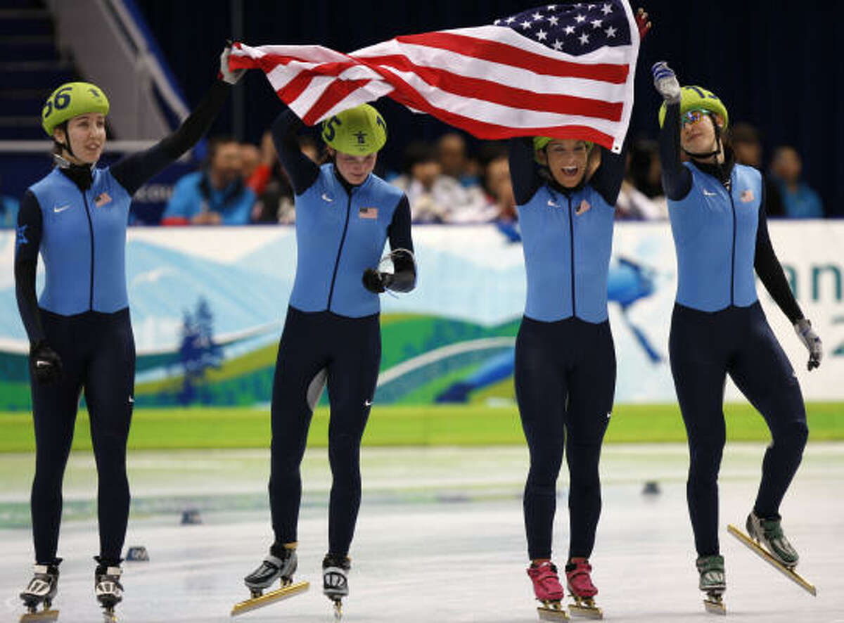 Team United States celebrates its surprise bronze medal win after the team from the Republic of Korea were disqualified.